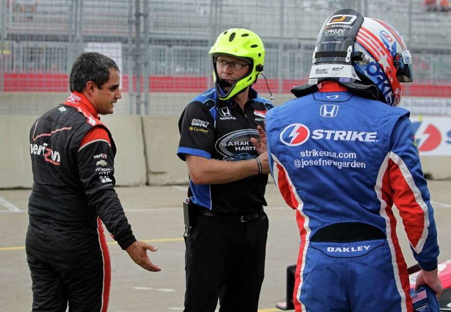 IndyCar driver Juan Pablo Montoya, left, confronts IndyCar driver Josef Newgarden, right,  after a qualifying session of the IndyCar Series Race #2 at the Grand Prix of Houston at NRG Park Sunday, June 29, 2014, in Houston. Newgarden was penalized for impedding Montoya. Photo: Melissa Phillip, Houston Chronicle / © 2014  Houston Chronicle