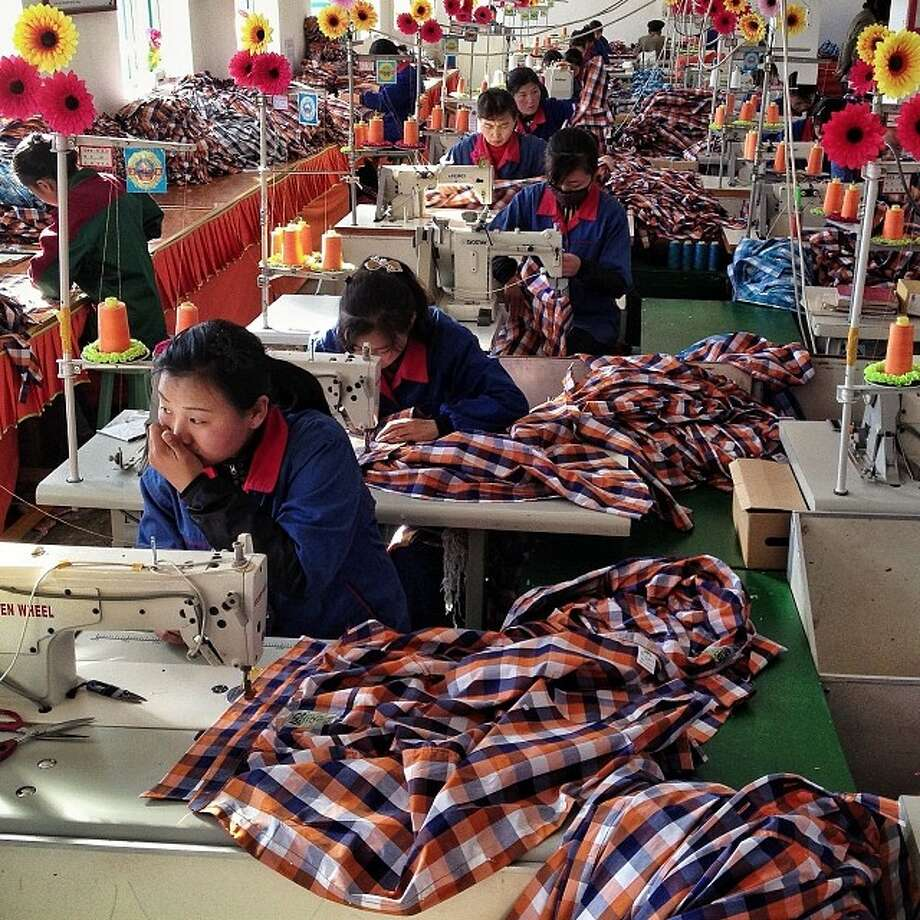 "North Korean seamstresses work at rows of sewing machines at the Sonbong Textile Factory inside the Rason Special Economic Zone.Related story: Instagram North Korea: Incredible, haunting images that give a rare glimpse inside the world's most secretive regime ""These Instagram photos, taken by the Associated Press's chief Asia 