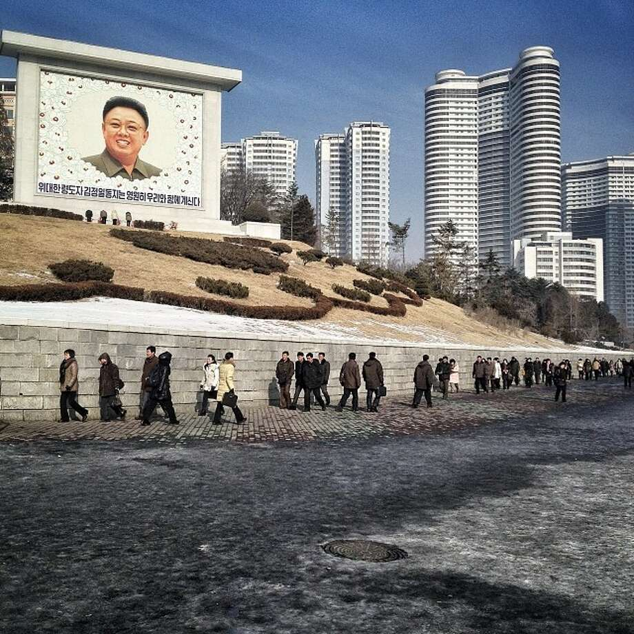 "Residents of Pyongyang walk by a mosaic of the late leader Kim Jong Il in the 2nd anniversary if his death.Related story: Instagram North Korea: Incredible, haunting images that give a rare glimpse inside the world's most secretive regime ""These Instagram photos, taken by the Associated Press's chief Asia photographer, David Guttenfelder, have given a remarkably rare glimpse into the ordinary lives of those living under the Kim dynasty."" Photo: David Guttenfelder, AP  / AP2014"
