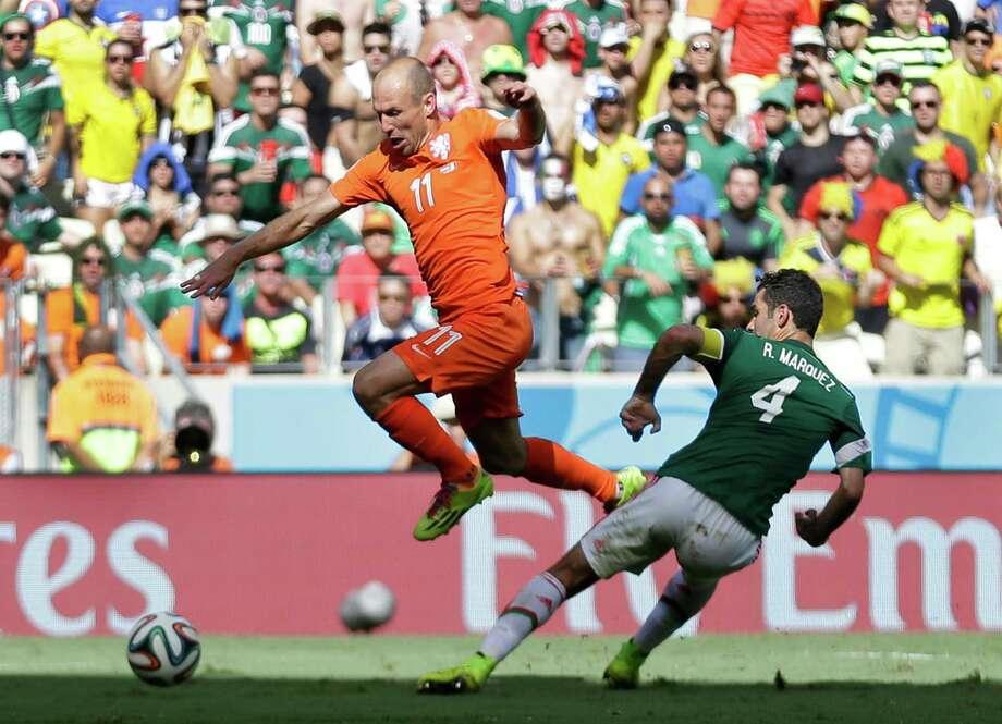 June 29  Netherlands 2, Mexico 1 Photo: Natacha Pisarenko, Associated Press / AP