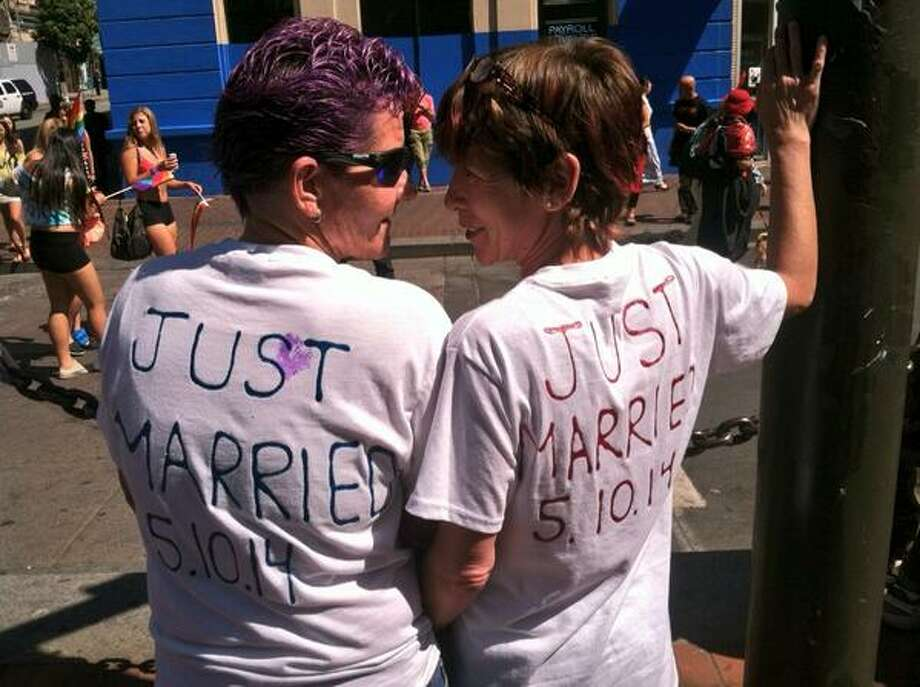 Tina and Kris celebrating their first San Francisco Pride Parade as a married couple. Photo: The Chronicle