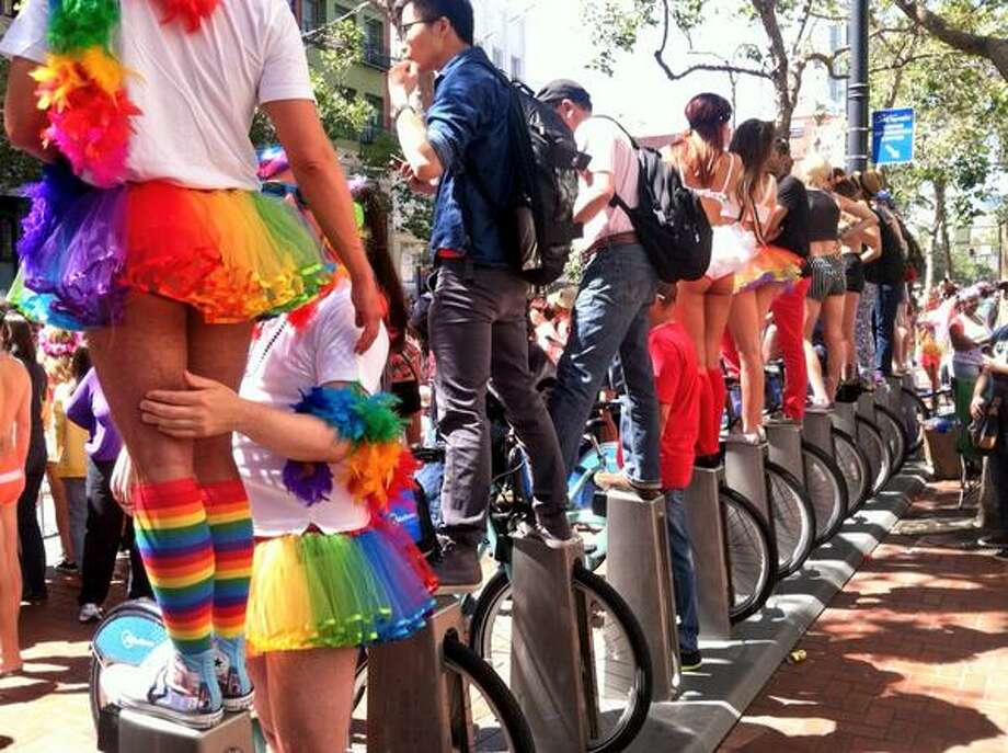 Bay Area Bike Share makes a great perch for watching the parade. Photo: The Chronicle