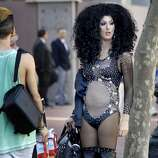 """Many were dressed for the hot weather as they gathered on Market Street. The annual Gay Pride parade on Market Street was held in San Francisco, Calif. Sunday June 29, 2014 and the theme was """"Color Our World With Pride."""""""
