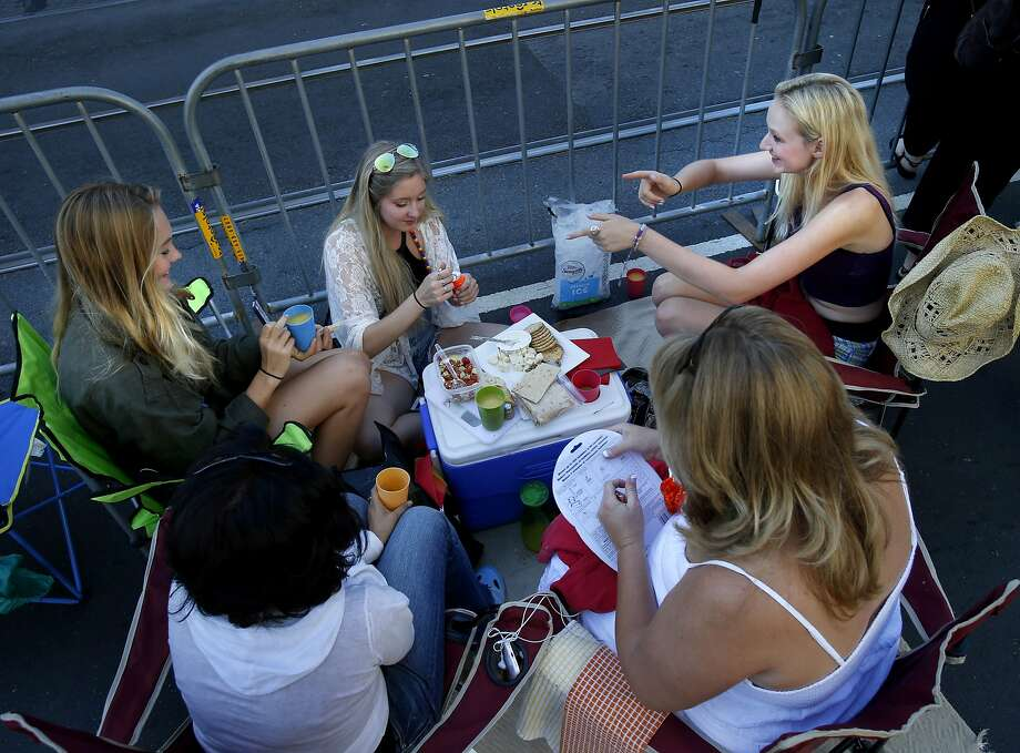"A group of women gathered near 8th and Market Street and enjoyed a picnic before the event. The annual Gay Pride parade on Market Street was held in San Francisco, Calif. Sunday June 29, 2014 and the theme was ""Color Our World With Pride."" Photo: Brant Ward, San Francisco Chronicle"