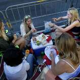 """A group of women gathered near 8th and Market Street and enjoyed a picnic before the event. The annual Gay Pride parade on Market Street was held in San Francisco, Calif. Sunday June 29, 2014 and the theme was """"Color Our World With Pride."""""""