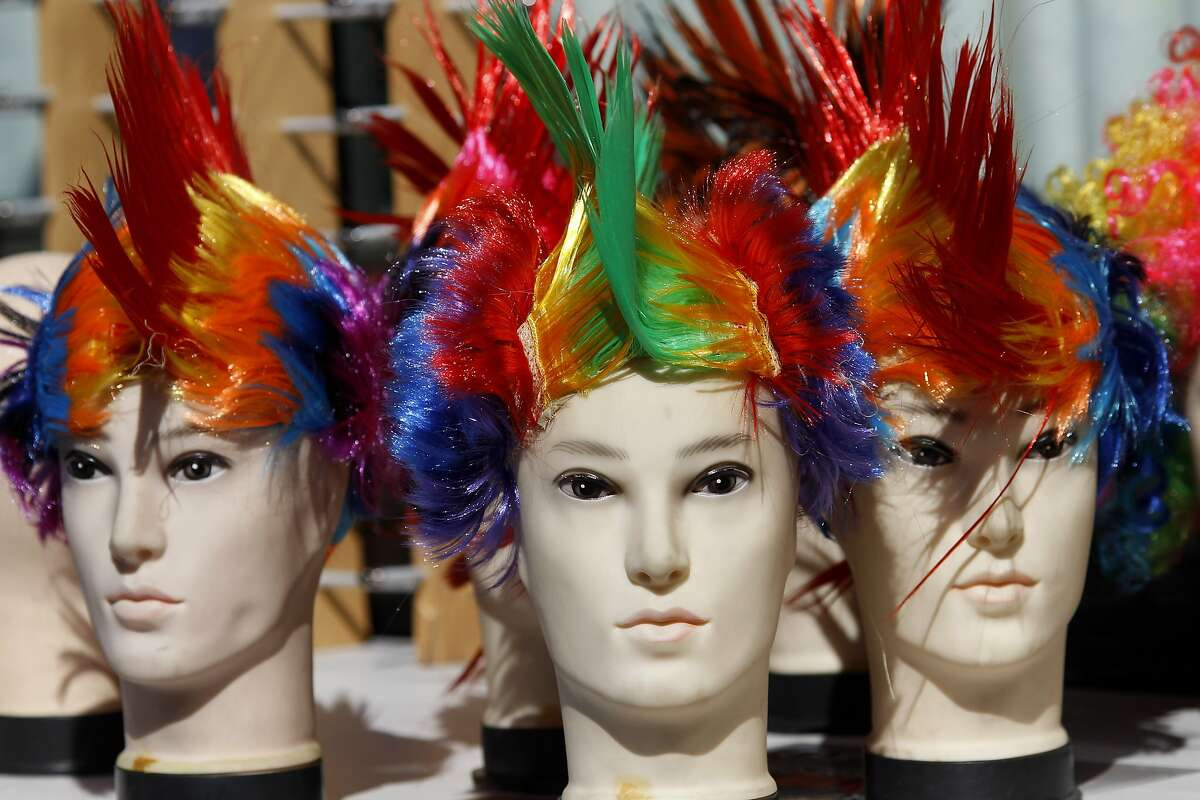 """An assortment of colorful wigs would fit right in, they were on sale on Market Street. The annual S.F. Pride parade on Market Street was held in San Francisco, Calif. Sunday June 29, 2014. The theme was """"Color Our World With Pride."""""""