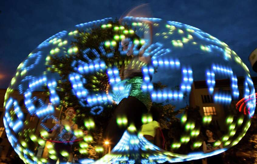 A hooper performs with an illuminated hula hoop at the Hula Hoop Festival Hoopurbia 2014 in Berlin,