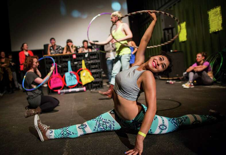 Hoopers perform with their hula hoops during a battle at the Hula Hoop Festival Hoopurbia 2014 in Be
