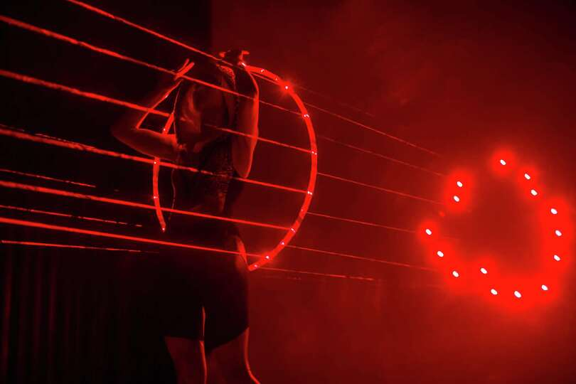 Canadian hooper Rebecca Halls performs with a hula hoop with laser beams at the Hula Hoop Festival H