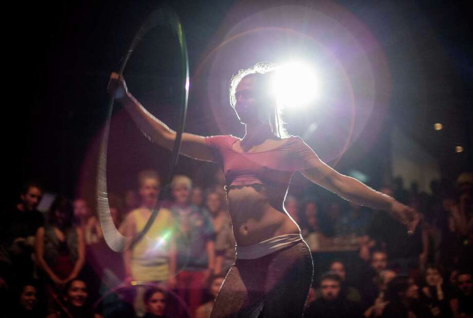 A hooper performs at the Hula Hoop Festival Hoopurbia 2014 in Berlin, Germany, Sunday, June 29, 2014. Hoopurbia 2014 is the third edition of an urban hula hoop festival bringing together hoopers from around the globe for six days of workshops, dance parties and performance showcases with hula hoops. Photo: Gero Breloer, AP  / AP