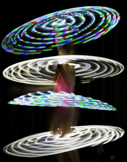 Canadian hooper Rebecca Halls performs with illuminated hula hoops at the Hula Hoop Festival Hoopurb