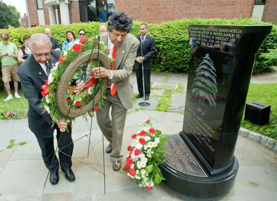 John Ashkar, President of the Lebanon American Club and Ghassan Najm, Assitant Secretary of the Lebanon American Club place a memorial wreath at the Lebanese-American monument during the 11th Annual Lebanon American Day Recognition Ceremony held at City Hall. Sunday, June 29, 2014 Photo: Scott Mullin / The News-Times Freelance
