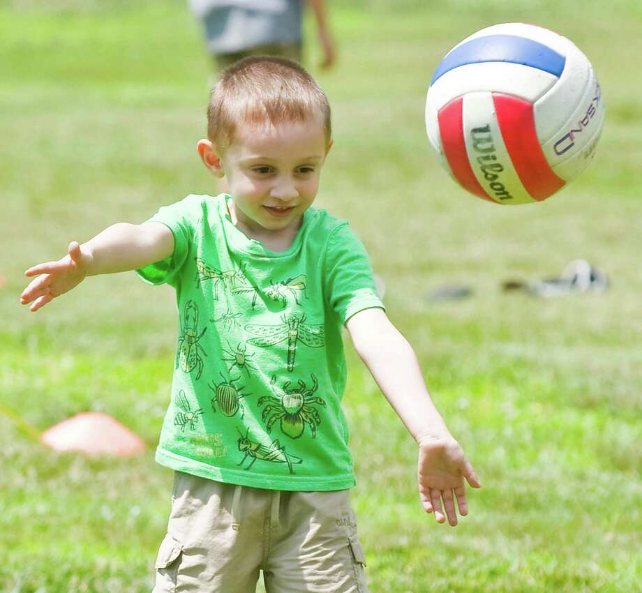 Gino Belcastro, 3, of Danbury, trying the volleyball game at the 90th anniversary celebration of the Amerigo Vespucci Lodge No. 160 in Danbury. Sunday, June 29, 2014 Photo: Scott Mullin / The News-Times Freelance
