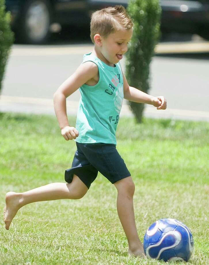 Brady Thatcher, 5, of Danbury, playing a soccer game at the 90th anniversary celebration of the Amerigo Vespucci Lodge No. 160 in Danbury. Sunday, June 29, 2014 Photo: Scott Mullin / The News-Times Freelance