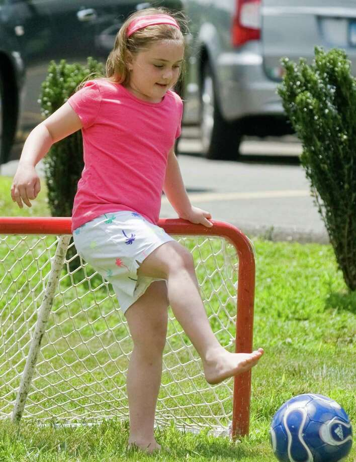 Gianna DeMasi, 7, of Brookfield, goaltending in a soccer game at the 90th anniversary celebration of the Amerigo Vespucci Lodge No. 160 in Danbury. Sunday, June 29, 2014 Photo: Scott Mullin / The News-Times Freelance