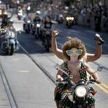 The Dykes on Bikes contingent provides the traditional start to the parade on Market Street.