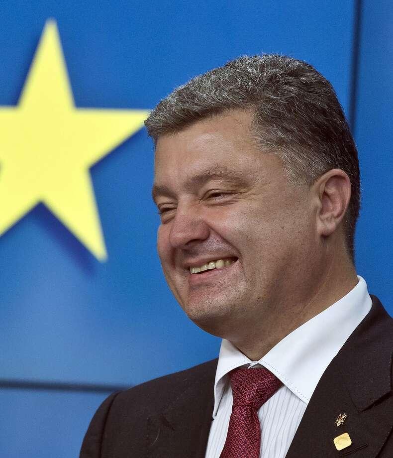 Ukrainian President Petro Poroshenko spoke with leaders of Russia, France and Germany. Photo: Michel Euler, Associated Press