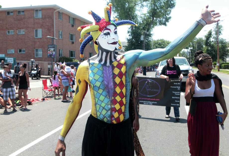 Brian Cobb with the Bridgeport Arts Fest marches in the 66th Annual Barnum Festival Great Street Parade in Bridgeport, Conn. on Sunday, June 29, 2014. Photo: BK Angeletti, B.K. Angeletti / Connecticut Post freelance B.K. Angeletti