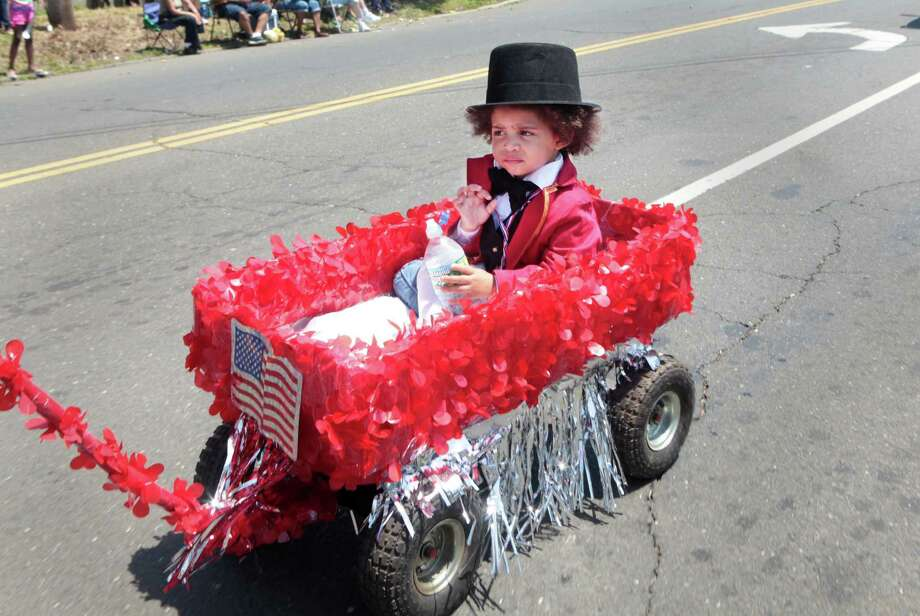 Malachi Thomas, 1, of Bridgeport, rides in the 66th Annual Barnum Festival Great Street Parade in Bridgeport, Conn. on Sunday, June 29, 2014. Photo: BK Angeletti, B.K. Angeletti / Connecticut Post freelance B.K. Angeletti