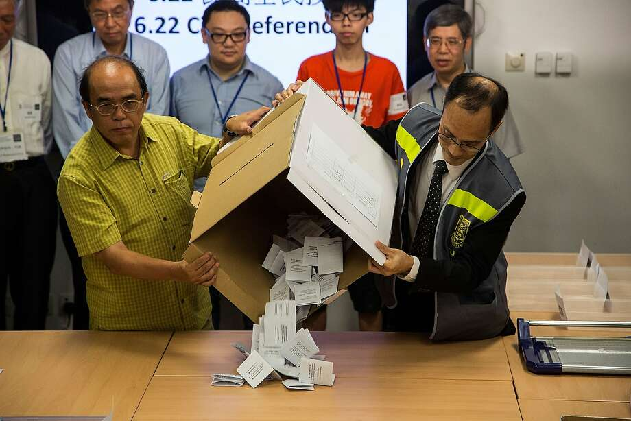 A ballot box is emptied onto a table for counting after a referendum on democratic reform in Hong Kong. More than 787,000 cast ballots. Photo: Lam Yik Fei, Getty Images