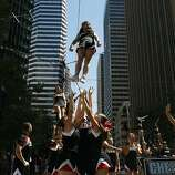 Members of Cheer SF perform a routine for parade-goers during the Pride Parade in San Francisco, Calif. on Sunday, June 29, 2014. The annual Pride Parade featured appearances from LGBT groups as well as local companies.