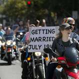 Left: A couple announce their wedding plans in the Dykes on Bikes contingent.
