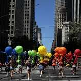 Pride Parade participants with balloons make their way down Market St. in San Francisco, Calif. on Sunday, June 29, 2014. The annual Pride Parade featured appearances from LGBT groups as well as local companies.