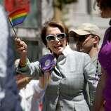 Parade participant Rep. Nancy Pelosi, D-San Francisco, celebrates progress made by the gay community.