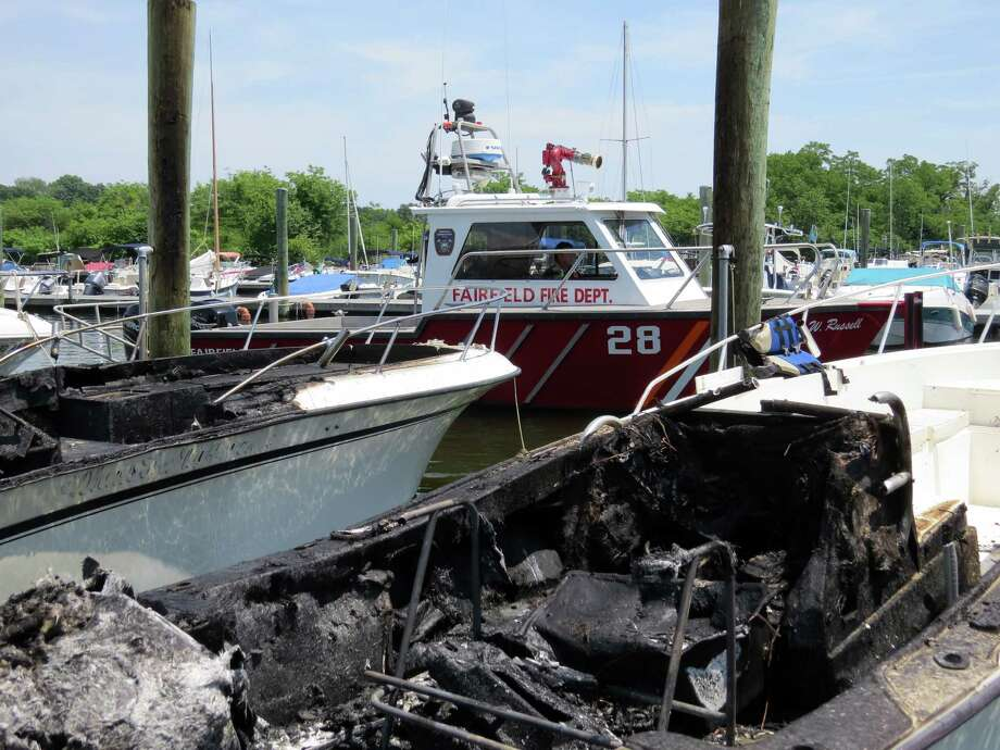 The aftermath of a fire that destroyed several boats Sunday at South Benson Marina. Photo: Fairfield Fire Department / Fairfield Citizen