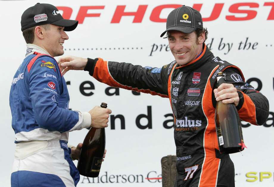 IndyCar driver Mikhail Aleshin, left, second place finisher, and Simon Pagenaud, right, first place finisher, hug during trophy ceremony at the IndyCar Series Race #2 at the Grand Prix of Houston at NRG Park Sunday, June 29, 2014, in Houston. Photo: Melissa Phillip, Houston Chronicle / © 2014  Houston Chronicle