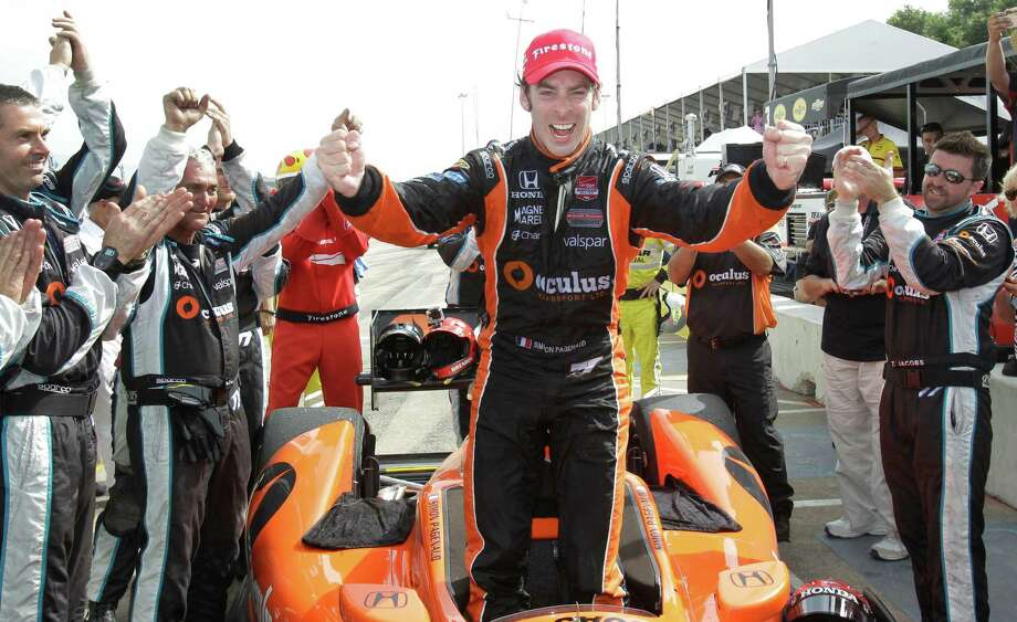 IndyCar driver Simon Pagenaud celebrates his win of the IndyCar Series Race #2 at the Grand Prix of Houston at NRG Park Sunday, June 29, 2014, in Houston. Photo: Melissa Phillip, Houston Chronicle / © 2014  Houston Chronicle