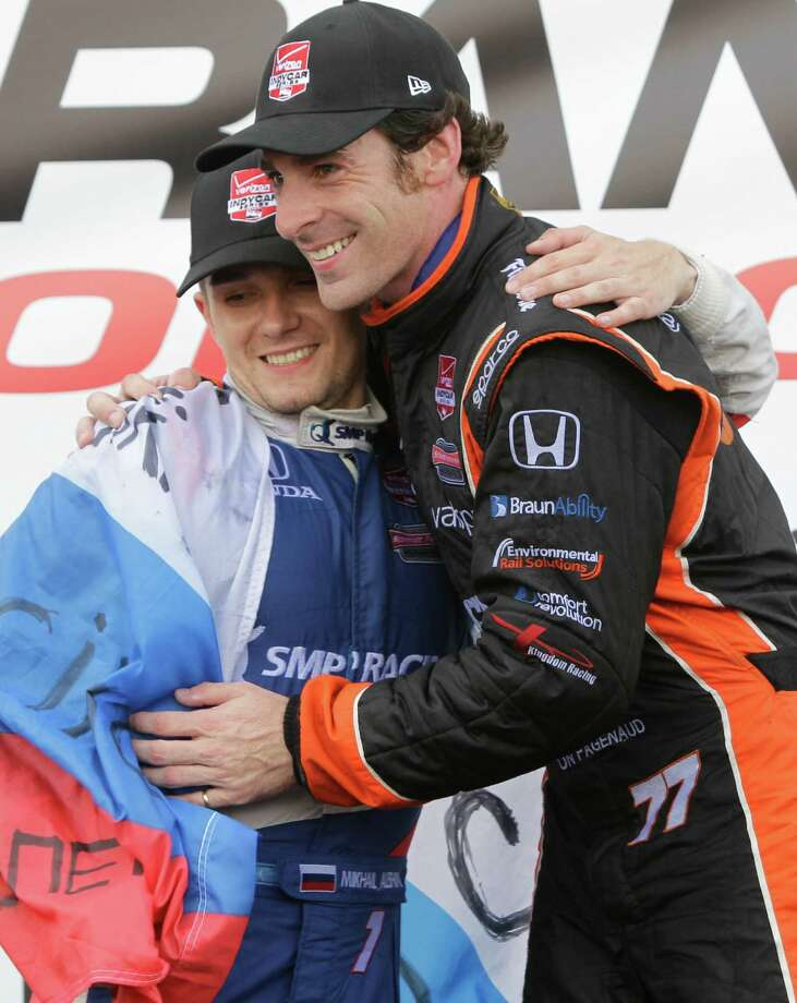 IndyCar driver Simon Pagenaud, right, first place finisher hugs teammate and second place finisher Mikhail Aleshin, left, during trophy ceremony at the IndyCar Series Race #2 at the Grand Prix of Houston at NRG Park Sunday, June 29, 2014, in Houston. Photo: Melissa Phillip, Houston Chronicle / © 2014  Houston Chronicle