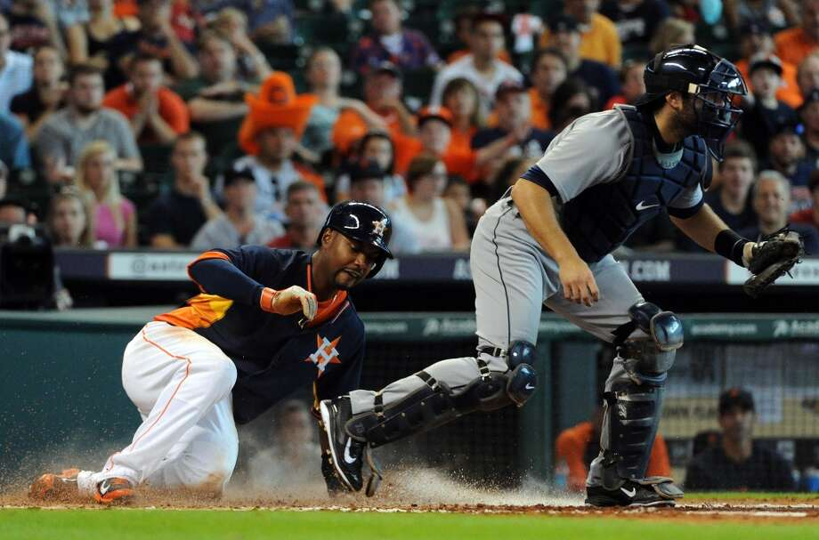 June 29: Astros 6, Tigers 4  Astros left fielder L.J. Hoes, left, is forced out at home. Photo: Eric Christian Smith, For The Chronicle