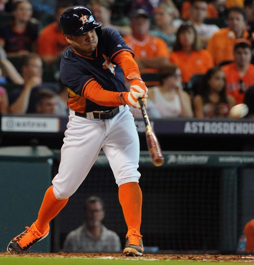Astros second baseman Jose Altuve connects for a base hit. Photo: Eric Christian Smith, For The Chronicle