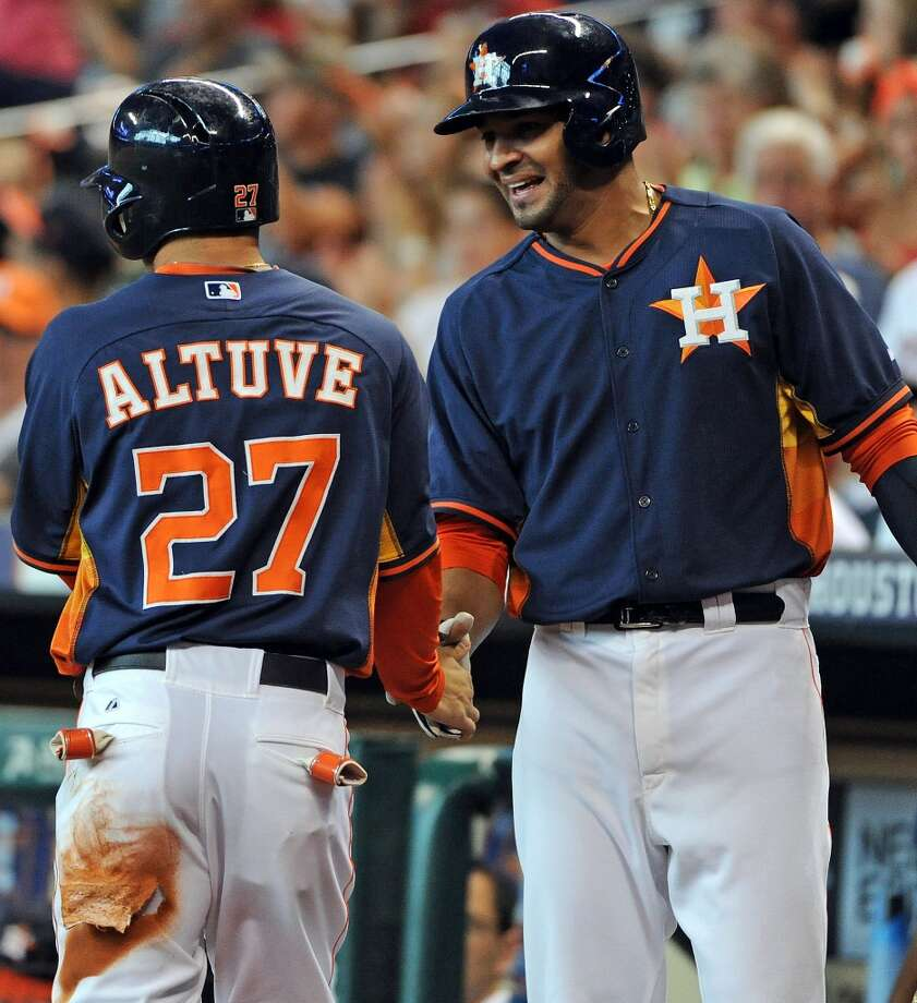 Astros designated hitter Jose Guzman, right, congratulates second baseman Jose Altuve after Altuve scored the first run of the game. Photo: Eric Christian Smith, For The Chronicle