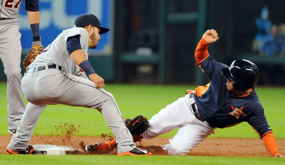 Astros second baseman Jose Altuve, right, steals second. Photo: Eric Christian Smith, For The Chronicle