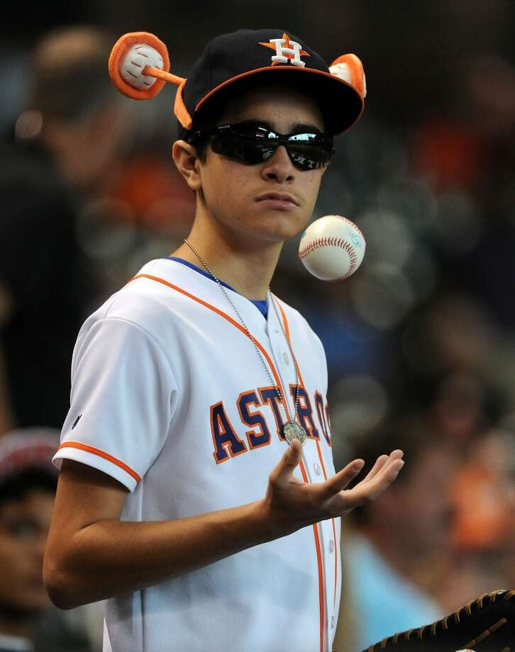 Astros fan Drew Matthew, 16, awaits the start of the game. Photo: Eric Christian Smith, For The Chronicle