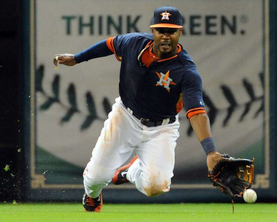 Astros left fielder L.J. Hoes can't catch the line drive of Tigers shortstop Eugenio Suarez. Photo: Eric Christian Smith, For The Chronicle