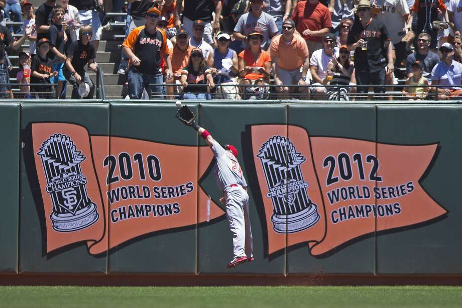Skip Schumaker catches Buster Posey's flyball in the first inning. The Giants were hitless until Posey singled in the seventh. Photo: Jason O. Watson, Getty Images