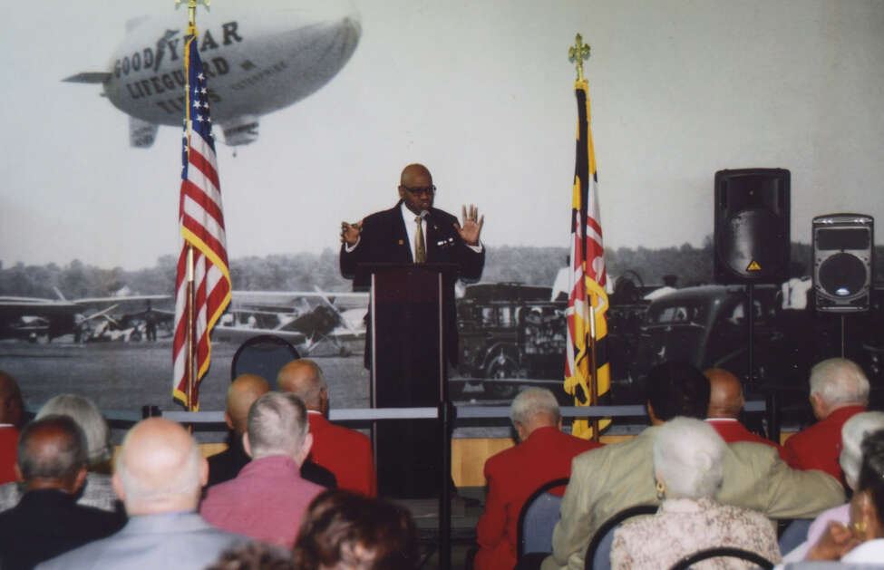 Allyn Hill of Greenbelt, Md., formerly of Lansingburgh, center, honors 11 Tuskegee Airmen and their guests at the College Park Aviation Mueum, Chery Point, Md.