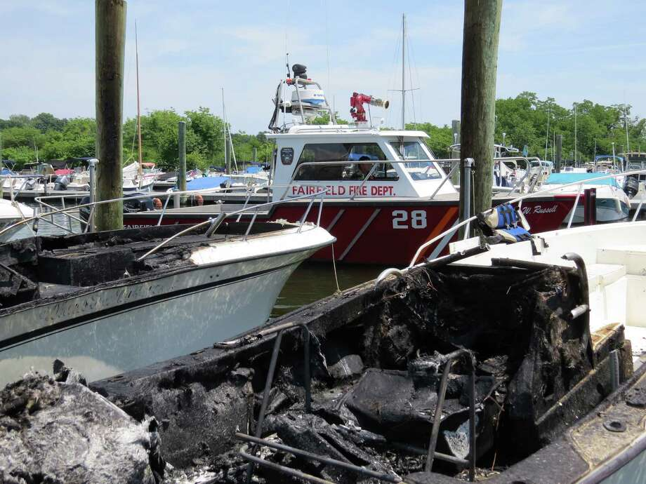 Fire officials said two boats were destroyed and a number of others were damaged by a fire at the South Benson Marina in Fairfield, Conn. on Sunday, June 29, 2014. Photo: Contributed Photo / Connecticut Post