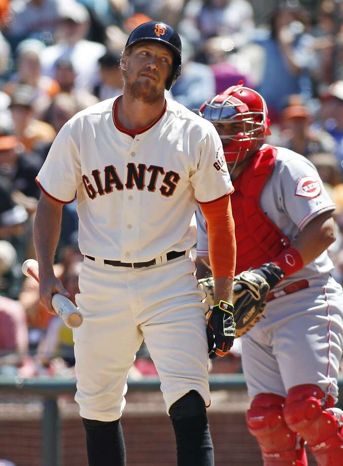 Hunter Pence shows some frustration after striking out against the Reds' Homer Bailey in the seventh inning. The loss dropped the Giants into a virtual tie for first place with the Dodgers. Photo: George Nikitin, Associated Press
