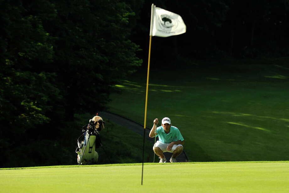 William Lanzoni lines up his shot on the 14th green during day two of the Men's Town Golf Championship at Griffith E. Harris Golf Course in Greenwich, Conn., on Sunday, June 29, 2014. Lanzoni won the Townwide championship trophy with a score of 149. Photo: Jason Rearick / Stamford Advocate