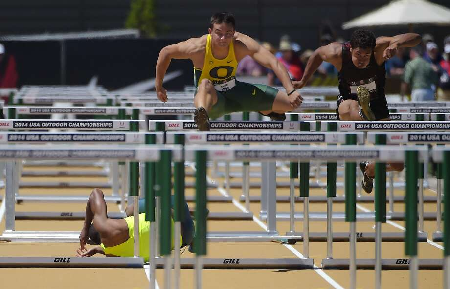 Ronnie Ash (left) falls as Devon Allen (center) clears a hurdle next to Ryan Wilson in the men's 110-meter hurdles final. Photo: Mark J. Terrill, Associated Press