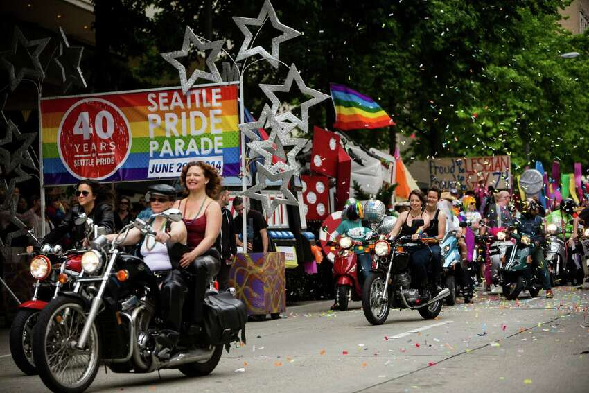 Dykes on Bikes lead off the 40th annual Seattle Pride Parade Sunday, June 29, 2014, in Seattle, Wash. This year's theme was