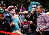 """George Takei, right, of Star Trek fame, poses for pictures with members of the Sisters of Perpetual Indulgence while acting as the Grand Marshall of the 40th annual Seattle Pride Parade Sunday, June 29, 2014, in Seattle, Wash. This year's theme was ÒGenerations of Pride."""""""