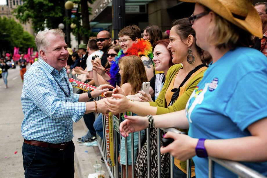 Seattle Mayor Ed Murray shakes hands during the 40th annual Seattle Pride Parade.  Murray was prime sponsor of marriage equality in the Legislature, and has become a champion of transgender rights at City Hall.  Photo: JORDAN STEAD, SEATTLEPI.COM / SEATTLEPI.COM