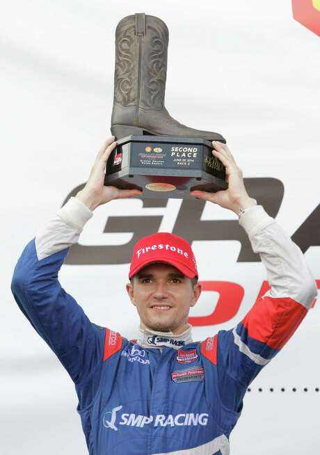 The second-place trophy represents the best finish of the season for rookie Mikhail Aleshin of Russia. Photo: Melissa Phillip, Staff / © 2014  Houston Chronicle