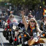 """The annual Dykes on Bikes contingent led off the parade. The annual Gay Pride parade on Market Street was held in San Francisco, Calif. Sunday June 29, 2014 and the theme was """"Color Our World With Pride."""""""