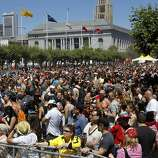 """Much of the park area on the Polk Street side of City Hall was covered with people celebrating after the parade. The annual Gay Pride parade on Market Street was held in San Francisco, Calif. Sunday June 29, 2014 and the theme was """"Color Our World With Pride."""""""